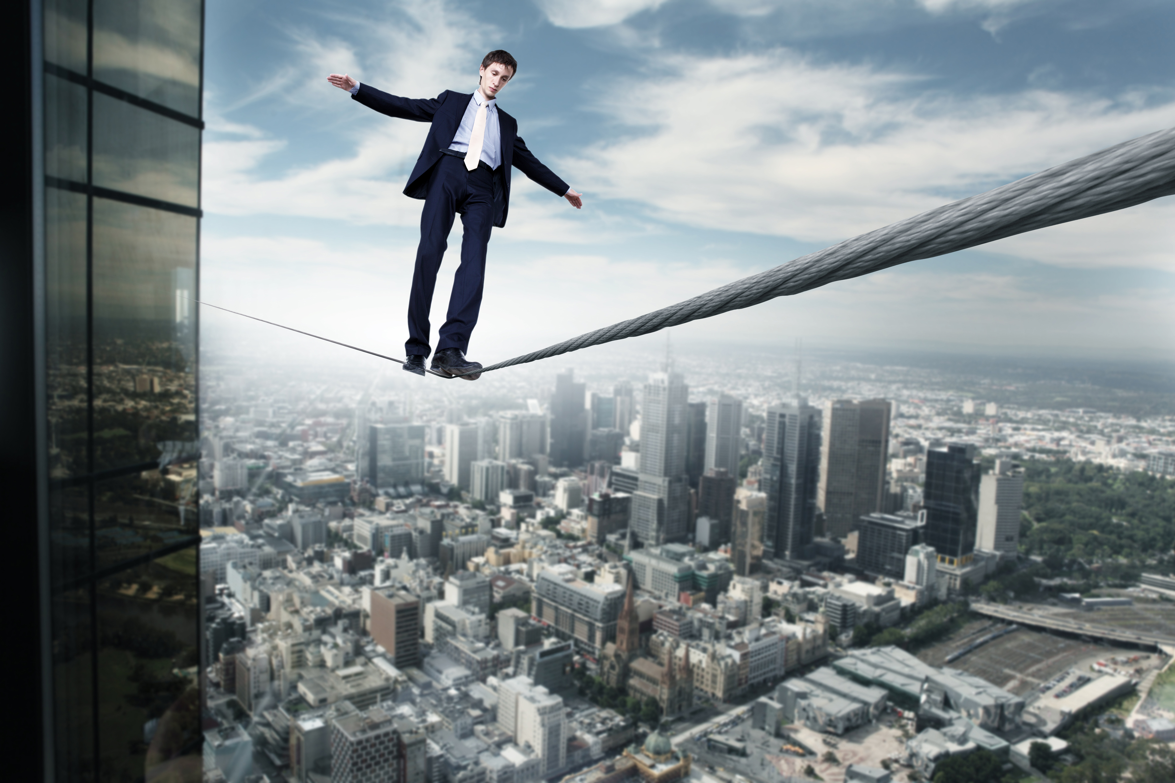 Business man balancing on the rope high in the sky-1